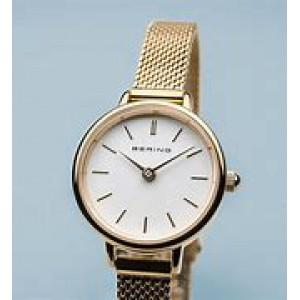 Bering horloge waarvan kast en milanaise band geel zijn verguld en lichte wijzerplaat / 11022-334 - 212897
